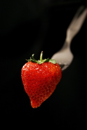 Strawberry on fork Stock Photo - 12642989