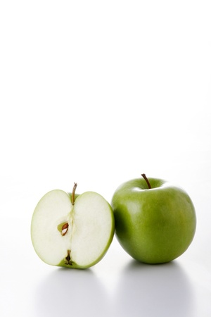One whole and one half green apples Stock Photo - 12642992