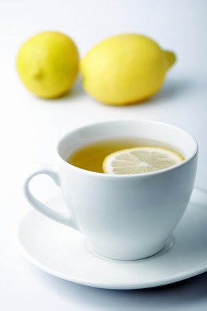 Two whole lemons and a cup of lemon tea