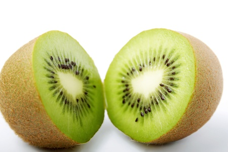 Two halved kiwi fruits Stock Photo - 12643038