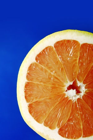Halved orange against blue background Stock Photo - 12643042
