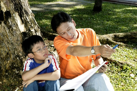 Man teaching his son how to draw Stock Photo - 12643178