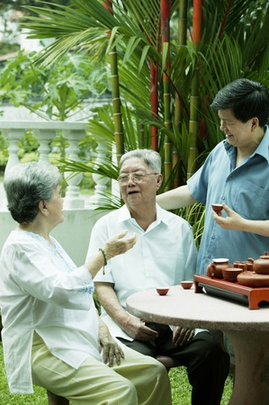 Man drinking tea with his parents Stock Photo - 12643194