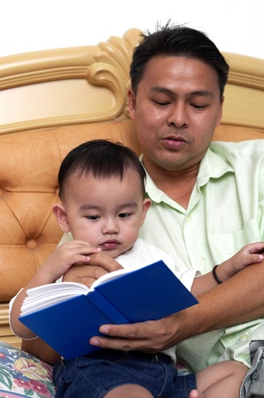 Man reading a bedtime story for his son Stock Photo - 12643289