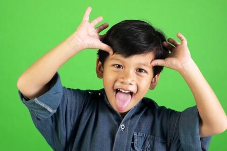 Studio shot of boy making funny facial expression Stock Photo - 12643345