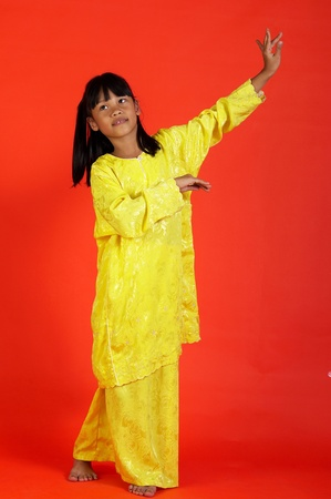 Studio shot of girl showing off her talent in malay dance Stock Photo - 12643363