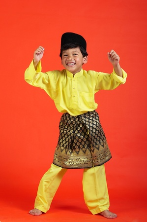 Studio shot of boy showing off his talent in malay dance Stock Photo - 12643364