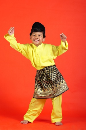 Studio shot of boy showing off his talent in malay dance LANG_EVOIMAGES