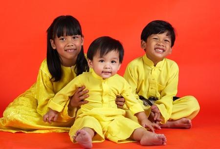 Studio shot of girl and her younger brothers Stock Photo - 12643372