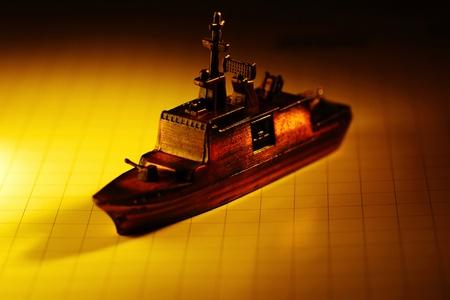 Mini ocean liner on a nautical chart Stock Photo - 12643454