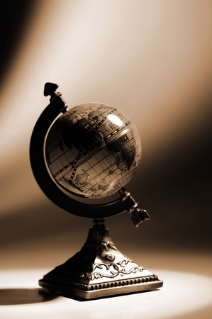 Sepia picture of a globe on the table Stock Photo - 12643455