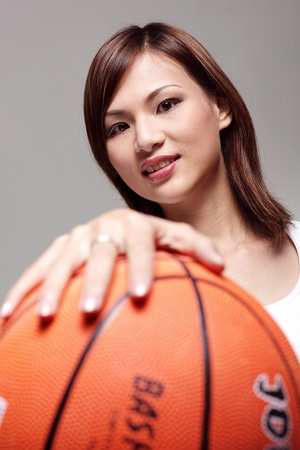 Studio shot of woman playing basketball Stock Photo - 12643489