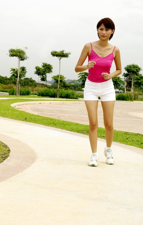 Woman jogging in the park Stock Photo - 12643524