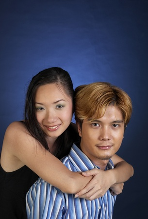 Studio shot of woman locking her hands around her boyfriend's neck Stock Photo - 12643566