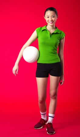 Studio shot of woman posing with a volleyball Stock Photo - 12643751