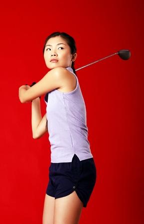Studio shot of woman playing golf Stock Photo - 12643811