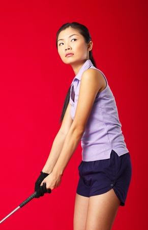 Studio shot of woman playing golf Stock Photo - 12643812