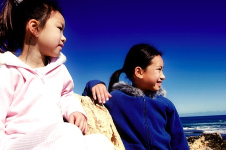 Two girls admiring the sea view from the top Stock Photo - 12643886