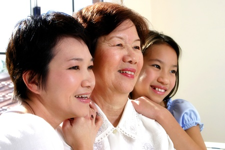 Girl posing with her mother and grandmother Stock Photo - 12643938