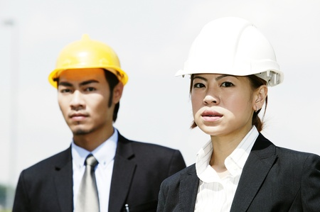 Two architects wearing safety helmets Stock Photo - 12644031