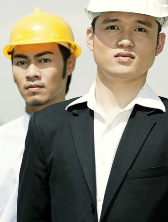 Two architects wearing safety helmets Stock Photo - 12644032