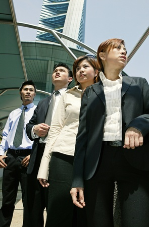 Low angle view of a group of business people Stock Photo - 12644041