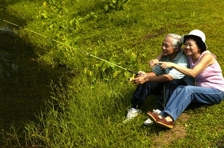 Old couple fishing by the lake Stock Photo - 12644055