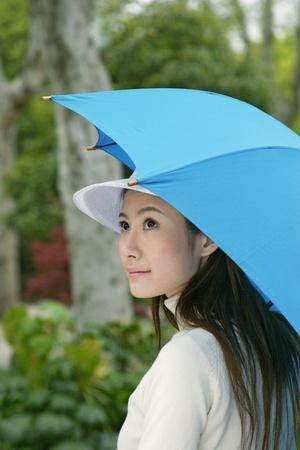 Woman holding an umbrella. Stock Photo - 12644126