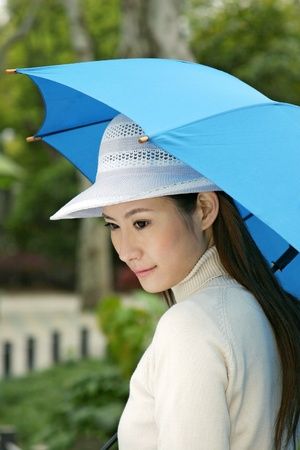 Woman holding an umbrella. Stock Photo - 12644129
