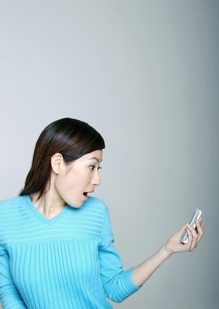 Woman in shock. Stock Photo - 12644151