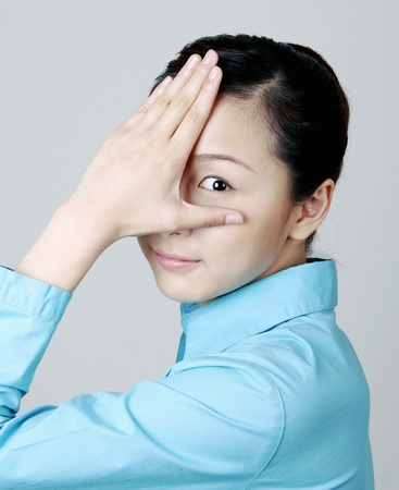 Woman covering eye with her hand. Stock Photo - 12644174