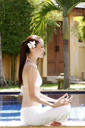Woman meditating. Stock Photo - 12644250