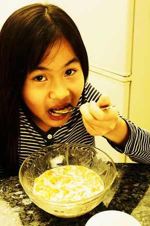 Girl having breakfast cereal Stock Photo - 12644456