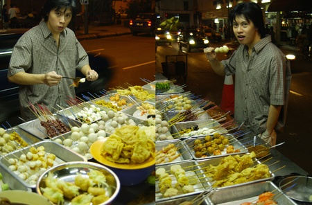 Man eating at a roadside stall Stock Photo - 12644497