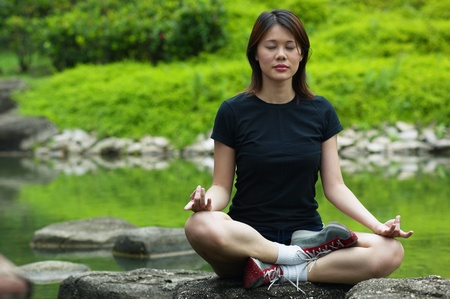 Woman meditating Stock Photo - 12644504