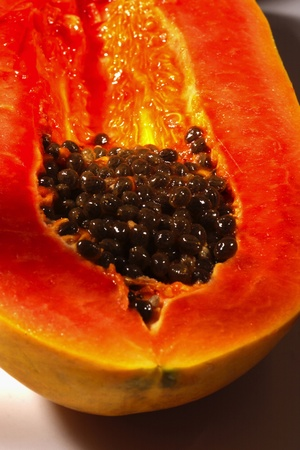 The interior of a cut papaya revealing its seeds Stock Photo - 12644635