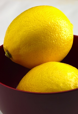Two lemons in a bowl Stock Photo - 12644636