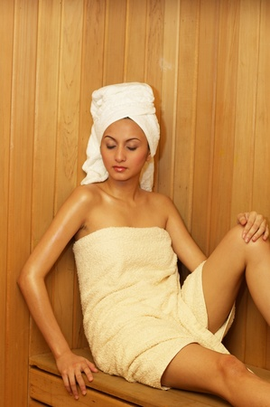 Woman in towel having steam bath Stock Photo - 12644676