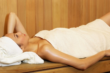 Woman in towel having steam bath Stock Photo - 12644696