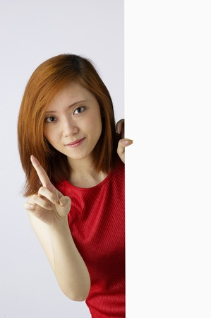 Woman holding white board Stock Photo - 12644760