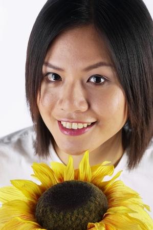 Woman holding sunflower Stock Photo - 12644799