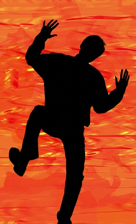 Silhouette of a man in action Stock Photo - 12644910