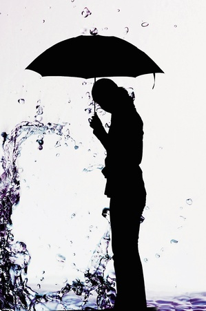 Silhouette of woman holding an umbrella Stock Photo - 12644955