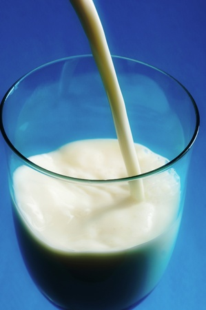 Pouring milk into a glass Stock Photo - 12644984