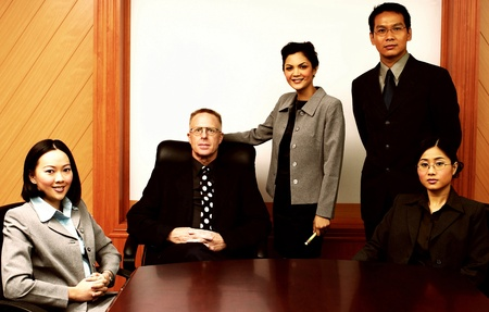 Manager and his assistants posing in the conference room Stock Photo - 12645041