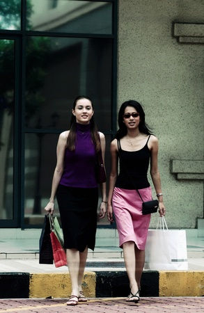 Two women crossing the road together Stock Photo - 12645177