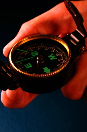 Hand holding a compass looking for direction Stock Photo - 12645186