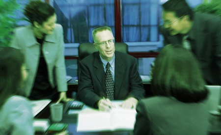 Manager dividing tasks to his subordinates Stock Photo - 12645320