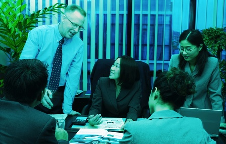 Manager discussing a project with her subordinates Stock Photo - 12645329