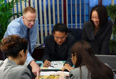 Manager discussing a project with his subordinates Stock Photo - 12645331